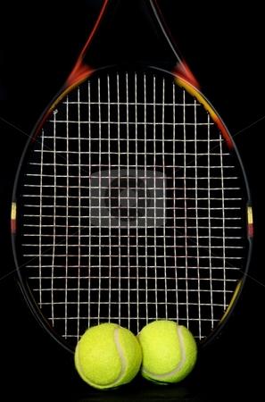 Tennis stock photo, Tennis raquet and tennis balls on a black background. by Chris Yates
