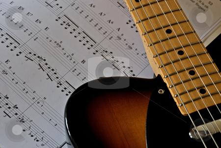 Guitar Music stock photo, Electric guitar shown next to sheet music. by Chris Yates