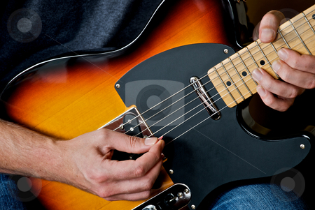 Guitar Player stock photo, Playing and bending string on electric guitar. by Chris Yates