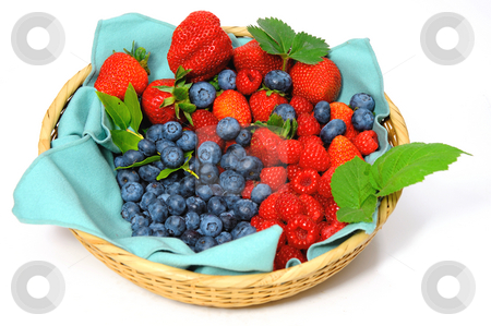 Blueberries, Strawberries and Raspberries stock photo, Assorted seasonal berries in a wicker basket including blueberry, strawberry and raspberry by Lynn Bendickson