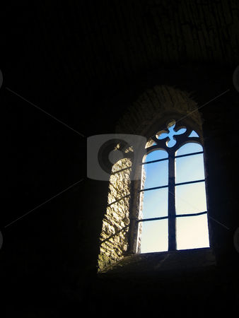 Light from the window stock photo, Light coming in from a window of an old Estonian church by Alessandro Rizzolli
