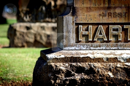 Rest Hart stock photo, Old gray gravestone in cemetery with partial writing. by Henrik Lehnerer