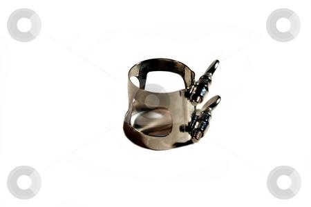 Ligature stock photo, A metal silver clarinet ligature on white background. by Henrik Lehnerer