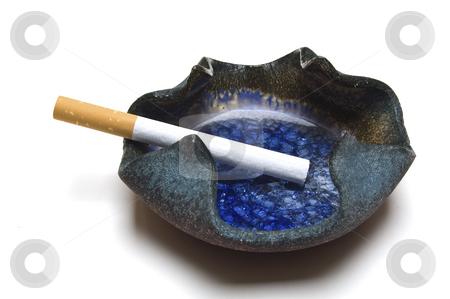 Cigarette in ashtray stock photo, Cigarette in stylish hand-made ashtray. by Jeff Carson