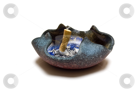 Stubbed out cigarette in ashtray stock photo, A cigarette stub in a ashtray. by Jeff Carson