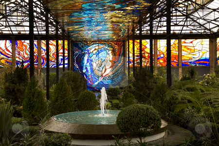 Cosmovitral Botanical Garden Surrounded by Stained Glass Toluca  stock photo, Cosmovitral Botanical Garden in Toluca, Mexico is surrounded by stained glass.  This side of the botanical garden represents chaos. by William Perry