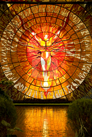 Sun Man Cosmovitral Botanical Garden Toluca Mexico stock photo, Cosmovitral Botanical Garden in Toluca Mexico is surrounded by stained glass.  This is Sun Man. by William Perry