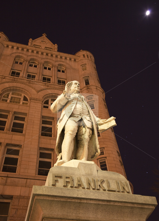 Benjamin Franklin Statue Old Post Office Building Washington DC stock photo, Benjamin Franklin Statue Old Post Office Building Pennsylvania Ave Washington DC with stars, planets, moon and orion constellation in the background by William Perry