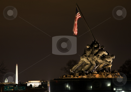 The Marine Corps War Iwo Jima Memorial Washington DC With Monume stock photo, The Marine Corps War Memorial Shows the Raising of the Flag at Iwo Jima in World War II  Washington DC  Statue finished in 1954.  Lincoln Memorial, Washington Monument and Capital in the background. by William Perry