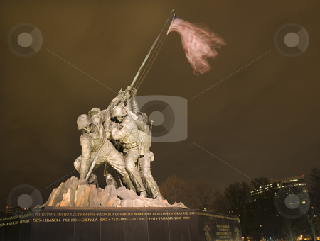 The Marine Corps War Memorial Rosslyn Buildings Washington DC stock photo, The Marine Corps War Memorial Shows the Raising of the Flag at Iwo Jima in World War II  Washington DC  Rosslyn Buildings in Background Statue finished in 1954 by William Perry