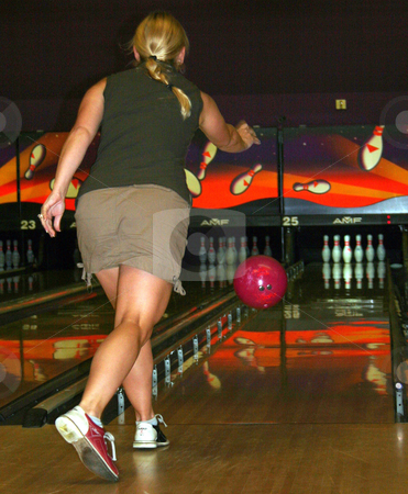 Bowling stock photo, A Woman just throwing the ball down the bowling alley. by Lucy Clark