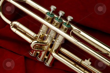 Trumpet on red suede stock photo, Close up shot of trumpet on red suede background by James Barber