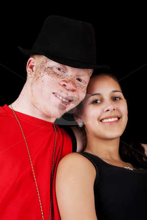 Diverse Couple stock photo, A young African albino man with a mixed-race Caucasian, African-American girl. by Brenda Carson