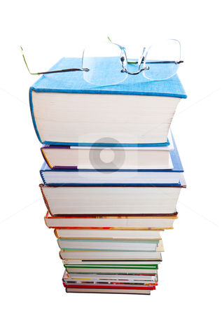 Higher Learning stock photo, A huge stack of text books with a pair of reading glasses on top. by Brenda Carson