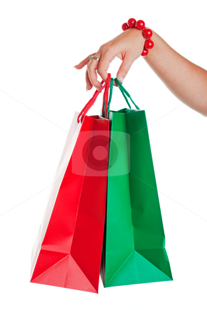 Christmas Shopping stock photo, Christmas shopper with red and green shopping bags.  Shot on white background. by Brenda Carson