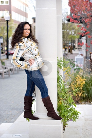 Stylish Young Woman stock photo, A young woman posing around on a large pillar outside. by Todd Arena