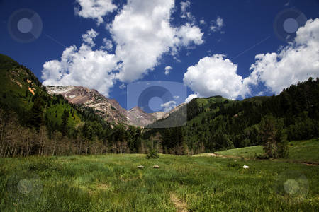 Rocky  Mountains stock photo, Roky Mountains in the Spring with blue sky and clouds by Mark Smith