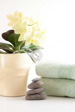 Orchied, massage stones and towels stock photo, Yellow orchid, massage stones, two towels isolated on white background by Alexander Zschach