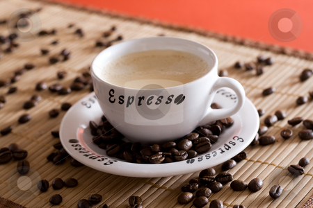Coffee cup stock photo, A espresso cup with coffee beans as decoration by Alexander Zschach