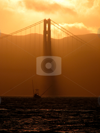 Golden Gate Sunset stock photo, A sunset at the Golden Gate Bridge with Fisher-Boat in foreground by Alexander Zschach