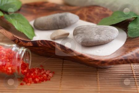 Bath salt, massage stones, bowl and sand stock photo, Massage stones on sand in a bowl and red bath salt by Alexander Zschach