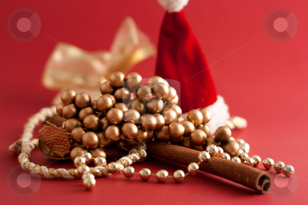 Christmas Theme stock photo, Chains, Santa Claus hat and cinnamon stick by Alexander Zschach