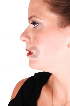 Portrait of young woman. stock photo, Young light red haired woman in an black dress standing in the studio  for white background, in profile with her great nice skin. by Horst Petzold