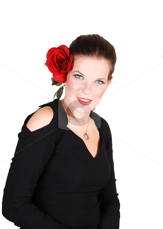 Portrait of young woman.. stock photo, Young light red haired woman in an black dress standing in the studio  for white background, with a big red rose in her hair. by Horst Petzold