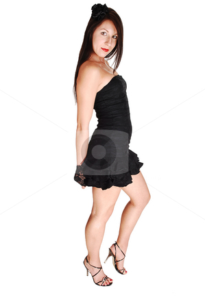 Pretty girl in black dress. stock photo, Young lovely girl in a short black dress with red lips and high heels standing in the studio for white background. by Horst Petzold