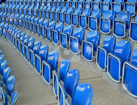 Seats stock photo, The photographic image of plastic folding chairs on sports arena. by citcarsten