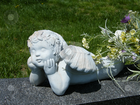 Resting Guardian Angel  stock photo, Resting Guardian Angel, setting on top of a grave marker. by Dazz Lee Photography