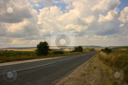 Country road stock photo, Road in farmlad with cloudy sky by Minka Ruskova-Stefanova