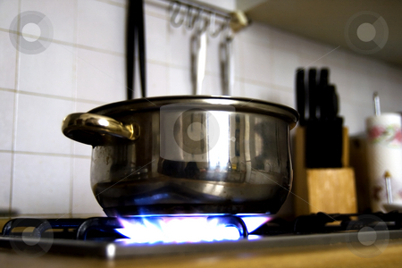 Kitchen stock photo, A Pot in a kitchen, fire lit, tools on the background by Fabio Alcini