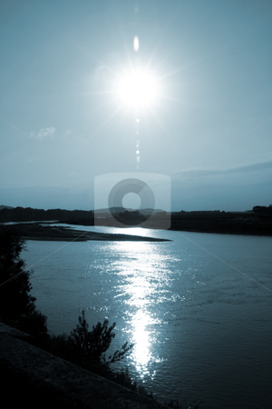 Sunset on the river stock photo, Beautiful sky and horizon reflection on water by Fabio Alcini
