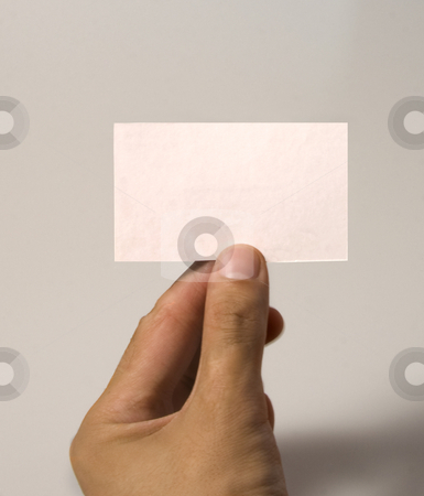 Business card stock photo, A white male hand holding a white empty business card by Fabio Alcini