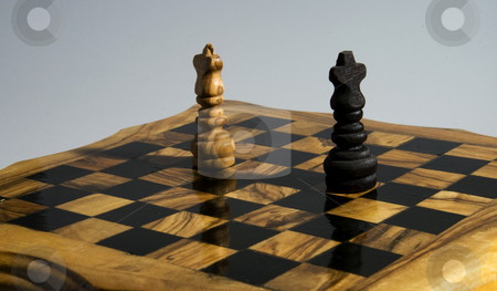 Chess stock photo, Lonely kings fronting each other before the final battle by Fabio Alcini