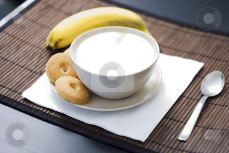 Breakfast stock photo, Breakfast with a cup of cappuccino with four biscuits and a banana by Fabio Alcini