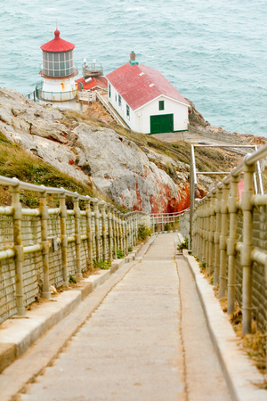 Point Reyes lighthouse, California stock photo, A steep ramp leads down to the Point Reyes National seashore lighthouse and outbuildings perched on cliffs above the Pacific Ocean by Hieng Ling Tie