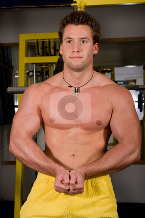 Bodybuilder posing stock photo, Young bodybuilder posing by Istv??n Cs??k