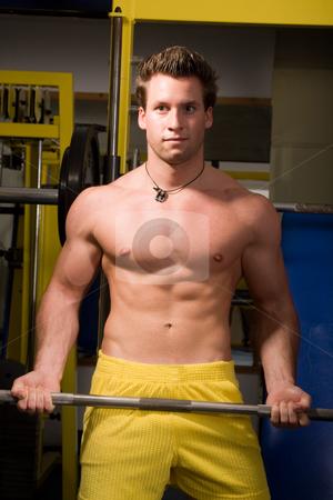 Bodybuilder training stock photo, Young Bodybuilder training by Istv??n Cs??k