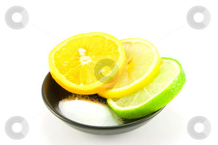 Citrus Fruit and Salt stock photo, Slice of lemon, lime and orange in a small black dish with salt on a white background by Keith Wilson