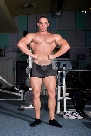 Bodybuilder posing stock photo, Bodybuilder posing in the gym by Istv??n Cs??k