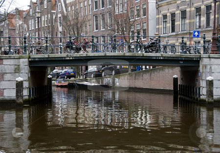 Amsterdam stock photo, Bridge in amsteram with a lot of bikes by Chris Willemsen