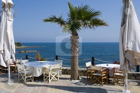 Sea view stock photo, A place for dinner with a view on the sea in greece on the island crete by Chris Willemsen