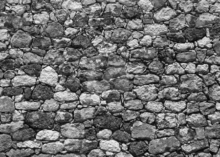 Ancient stone wall in greece black and white stock photo, Ancient stone wall in greece on the island crete by Chris Willemsen