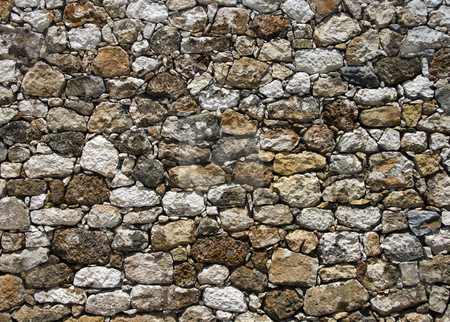 Ancient stone wall in greece stock photo, Ancient stone wall in greece on the island crete by Chris Willemsen