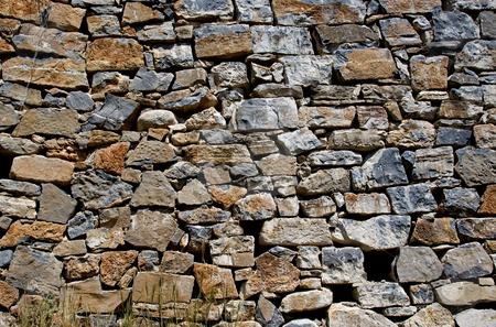 Old wall from stones stock photo, Old wall from stones in the old greece island crete as a wallpaper backgroubnd by Chris Willemsen