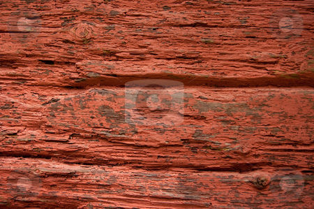Old Red Paint stock photo, Old red paint falling of a wooden wall. by Peter Soderstrom