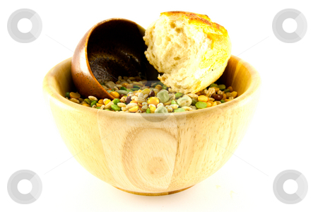 Soup Pulses and Crusty Bread stock photo, Wooden bowl of soup pulses with crusty bread on a white background by Keith Wilson
