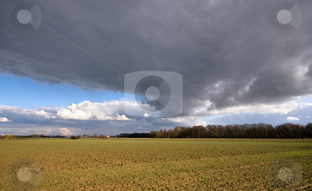 Giant big dark sky stock photo, Very giant big dark sky over farmland by Karin Claus